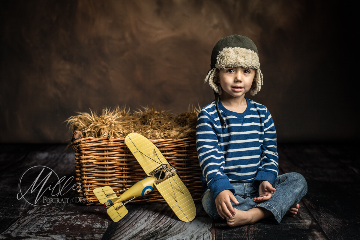 Two Year Portrait with Yellow Airplane and Wicker Basket